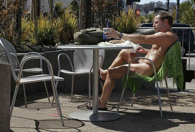 Eric Anderson, enjoys a cold beverage and a sandwich while in the nude at a parklet at the corner of 17th street and Castro in San Francisco, Ca. , on Tuesday September 6, 2011. Photo: Michael Macor, The Chronicle / SF