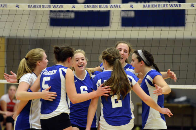 Darien celebrates a point during the girls volleyball match against Greenwich at Darien High School on Tuesday, Nov. 13, 2012. Photo: Amy Mortensen / Connecticut Post Freelance