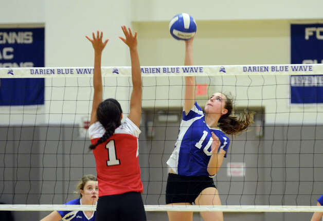 Darien's Taylor Cockerill (10) sends a shot over the net Greenwich's Jenny Cespedes (1) defends during the girls volleyball match at Darien High School on Tuesday, Nov. 13, 2012. Photo: Amy Mortensen / Connecticut Post Freelance
