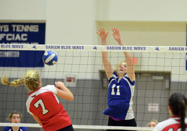 Darien's Claire Naughton (11) attempts to block a shot by Greenwich's Liza Johnson (7) during the girls volleyball match at Darien High School on Tuesday, Nov. 13, 2012. Photo: Amy Mortensen / Connecticut Post Freelance