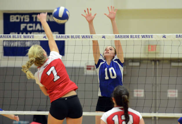 Darien's Taylor Cockerill (10) defends against a shot by Greenwich's Liza Johnson (7) during the girls volleyball match at Darien High School on Tuesday, Nov. 13, 2012. Photo: Amy Mortensen / Connecticut Post Freelance