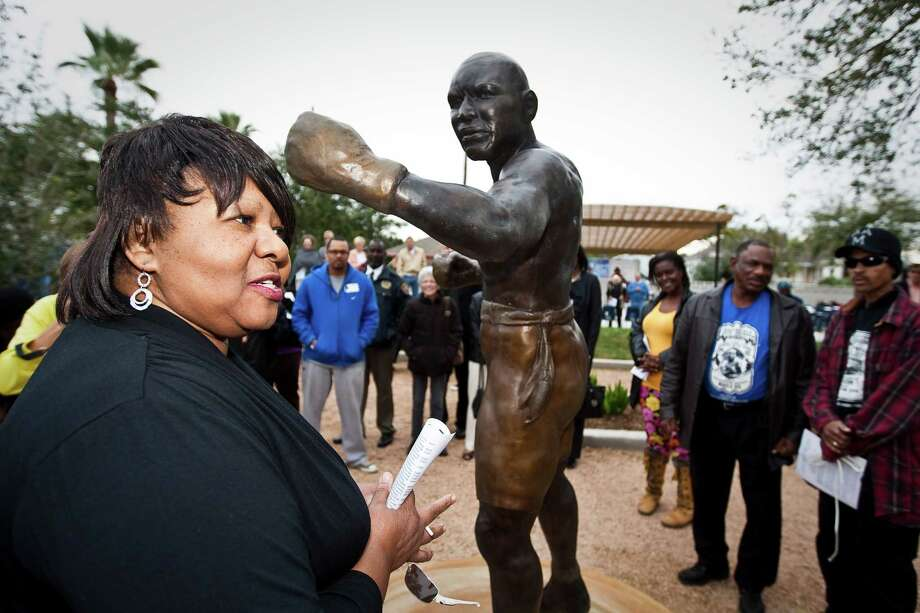 Linda Haywood, great great niece of legendary boxer Jack Johnson stands by a statue of her great great uncle during a dedication ceremony for Jack Johnson Park at the Old Central High School, Tuesday, in Galveston. Johnson was the first African American heavyweight champion. Photo: Nick De La Torre, Houston Chronicle / © 2012  Houston Chronicle