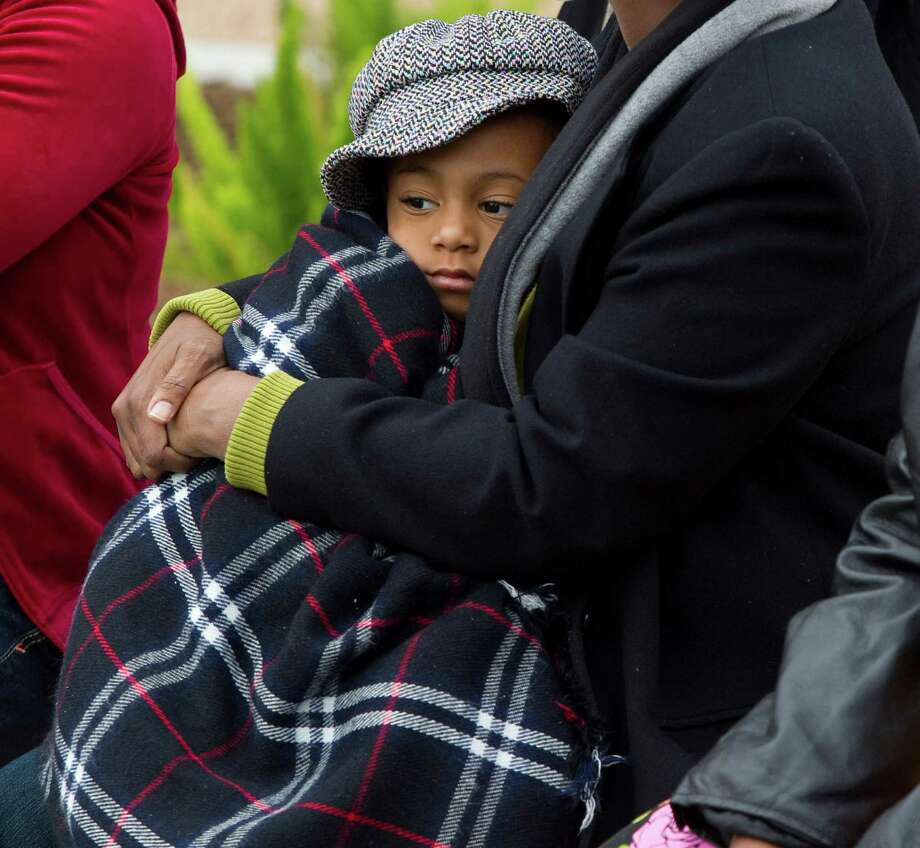 Cydney Gonzales, 3, of Gaveston, stays warm in her grandmother Bridgette Johnson's arms during a dedication ceremony for Jack Johnson Park at the Old Central High School, Tuesday, in Galveston. Johnson was the first African American heavyweight champion. Photo: Nick De La Torre, Houston Chronicle / © 2012  Houston Chronicle