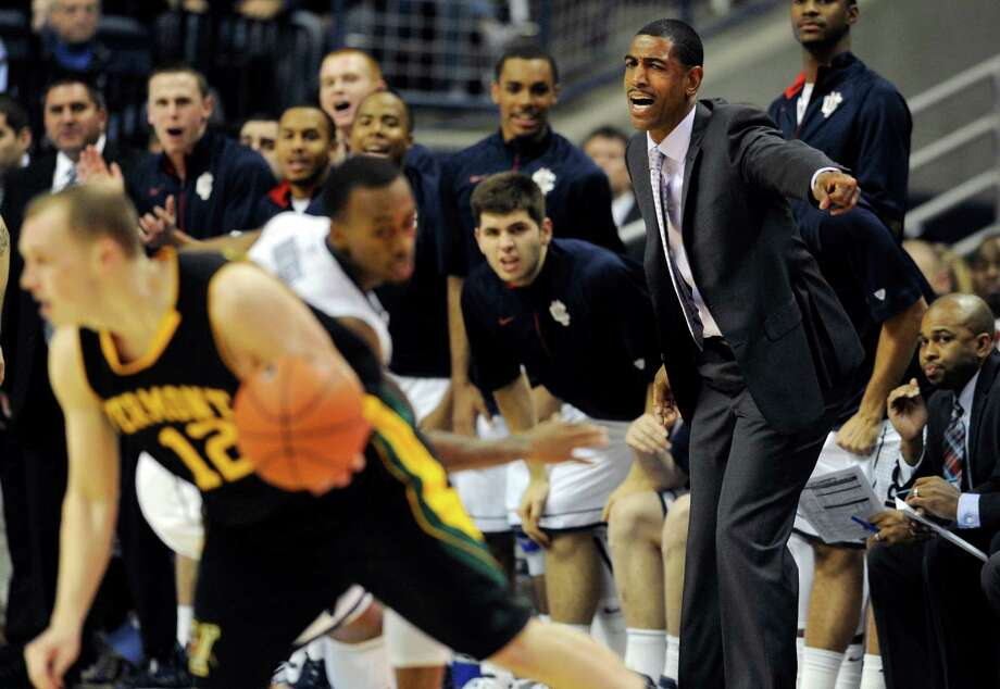 Connecticut head coach Kevin Ollie, right, gestures the first half of an NCAA college basketball game against Vermont in Storrs, Conn., Tuesday, Nov. 13, 2012. (AP Photo/Jessica Hill) Photo: Jessica Hill, Associated Press / FR125654 AP