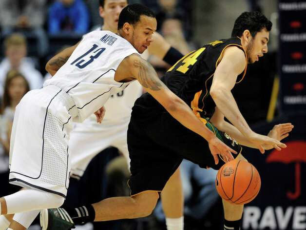 Connecticut's Shabazz Napier, left, steals the ball from Vermont's Josh Elbaum during the first half of an NCAA college basketball game against, Tuesday, Nov. 13, 2012, in Storrs, Conn. (AP Photo/Jessica Hill) Photo: Jessica Hill, Associated Press / FR125654 AP
