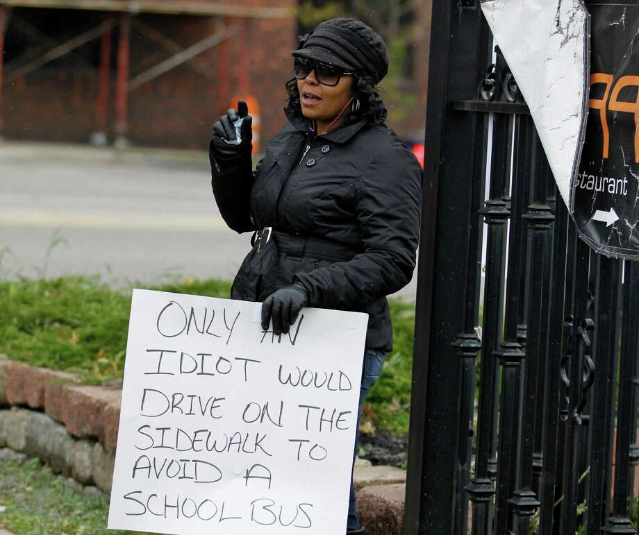 Shena Hardin of Cleveland was carrying this sign in near-freezing weather on Tuesday. Photo: Tony Dejak, STF / AP