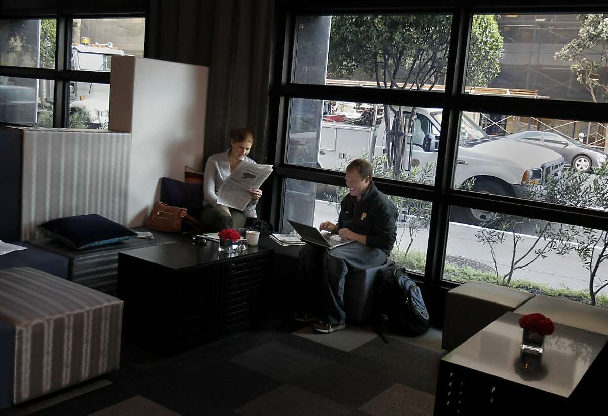 W Hotel guests in San Francisco read and work on their computers next to glass supplied by View Inc.