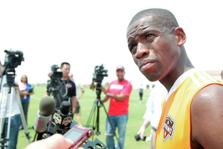 Oscar Boniek Garcia answers questions for the media after practice at Houston Amateur Sports Park's Methodist Champions Field on Thursday, June 28, 2012, in Houston. ( Mayra Beltran / Houston Chronicle ) Photo: Mayra Beltran, Staff / © 2012 Houston Chronicle