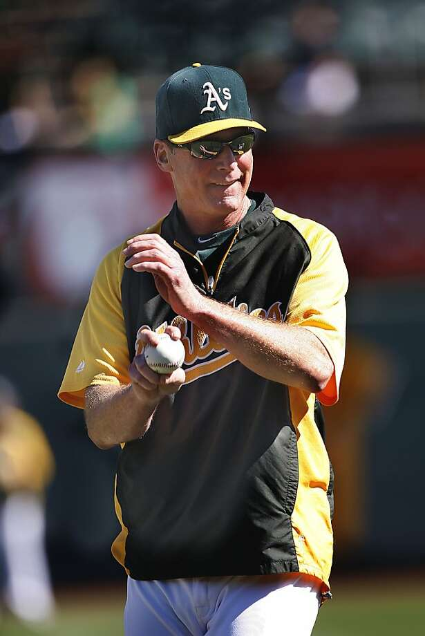 "AL Manager of the Year Bob Melvin expects ""to compete and win"" despite playing in a division with the Angels and Rangers. Photo: Liz Hafalia, The Chronicle"