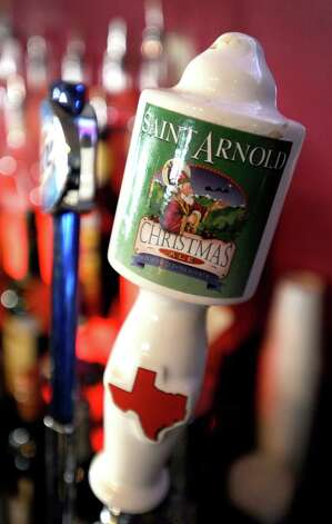 Saint Arnold Christmas Ale (7.00% ABV) is a Winter Warmer brewed by Saint Arnold Brewing Company.  This beer can be purchased on draft at Luke's on Calder.   Photo taken: Randy Edwards/The Enterprise