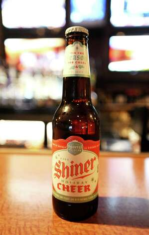 The Shiner Holiday Cheer (5.40% ABV) is an Dunkelweizen brewed by the Spoetzl Brewery out of Texas.  This beer can be purchased locally at Millers Liquor, Debb's Liquor (St. Charles Plaza), and Spec's.  You can also find it at local bars such as Luke's and The Office (located in Madisons).   Photo taken: Randy Edwards/The Enterprise