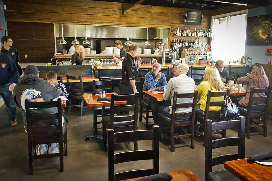 Surf Spot's dining room can get noisy when it's crowded, especially when the bar is busy, but the restaurant offers other seating options in front and back. Photo: John Storey, Special To The Chronicle