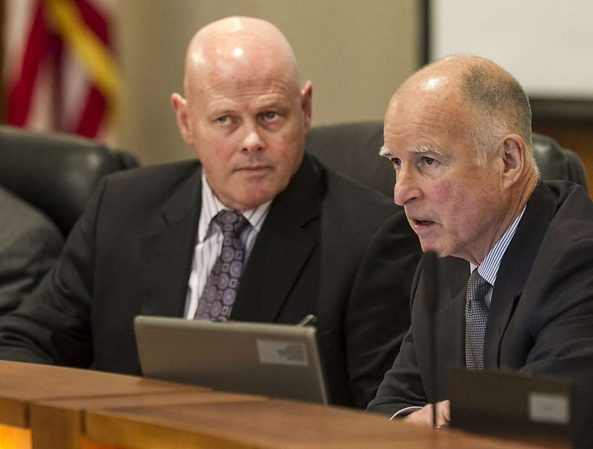 """Gov. Jerry Brown, right, urges the California State University board of trustees to keep costs down to maintain low tuition and fees in the 23-campus system, during a board meeting in Long Beach, Calif., Tuesday, Nov. 13, 2012. At left is Board chairman Robert Linscheid. Brown said the trustees must """"get out of their comfort zone"""" to control expenses. (AP Photo/Damian Dovarganes)"""