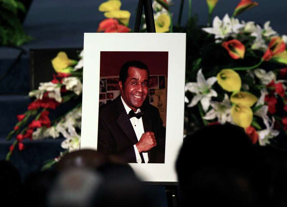 A portrait of the late boxing trainer Emanuel Steward is seen during his funeral service at the Greater Grace Temple in Detroit, Tuesday, Nov. 13, 2012. (AP Photo/Carlos Osorio) Photo: Carlos Osorio