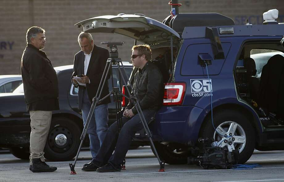 Security guard Art Michel  watches over  KPIX camera team  Ken Bastida  and  Zack Heene, Tuesday Nov. 13, 2012, outside the Oakland Police Substation in Oakland, Calif. Photo: Lacy Atkins, The Chronicle