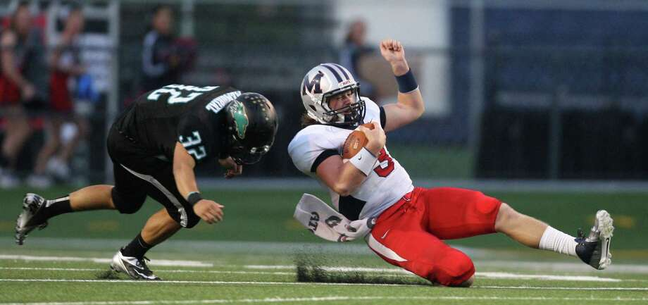 Manvel quarterback Shane McCarley (3) slides for a first down past Pasadena Memorial's Andrew Garzaduring the first half of a high school football game, Thursday, September 27, 2012 at Veterans Memorial Stadium in Pasadena, TX. Photo: Eric Christian Smith, Freelance