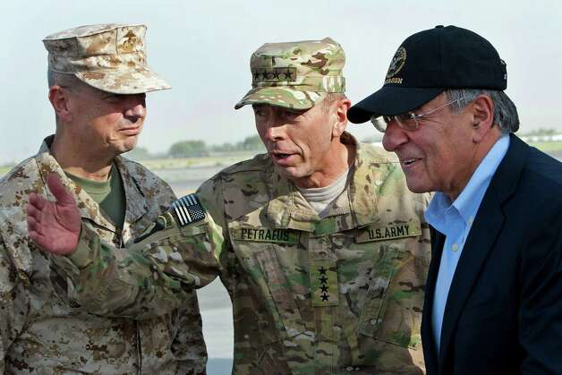FILE POOL - In this July 9, 2011 file photo, USMC Gen. John Allen, left, and Army Gen. David Petraeus, top U.S. commander in Afghanistan and incoming CIA Director, greet former CIA Director and new U.S. Defense Secretary Leon Panetta, right, as he lands in Kabul, Afghanistan, Saturday, July  9, 2011.  (AP Photo/Paul J. Richards, Pool) Photo: PAUL J. RICHARDS