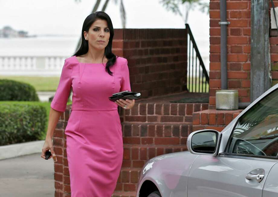 Jill Kelley leaves her home Tuesday, Nov 13, 2012 in Tampa, Fla. Kelley is identified as the woman who allegedly received harassing emails from Gen. David Petraeus' paramour, Paula Broadwell. She serves as an unpaid social liaison to MacDill Air Force Base in Tampa, where the military's Central Command and Special Operations Command are located. (AP Photo/Chris O'Meara) Photo: Chris O'Meara, STF / AP