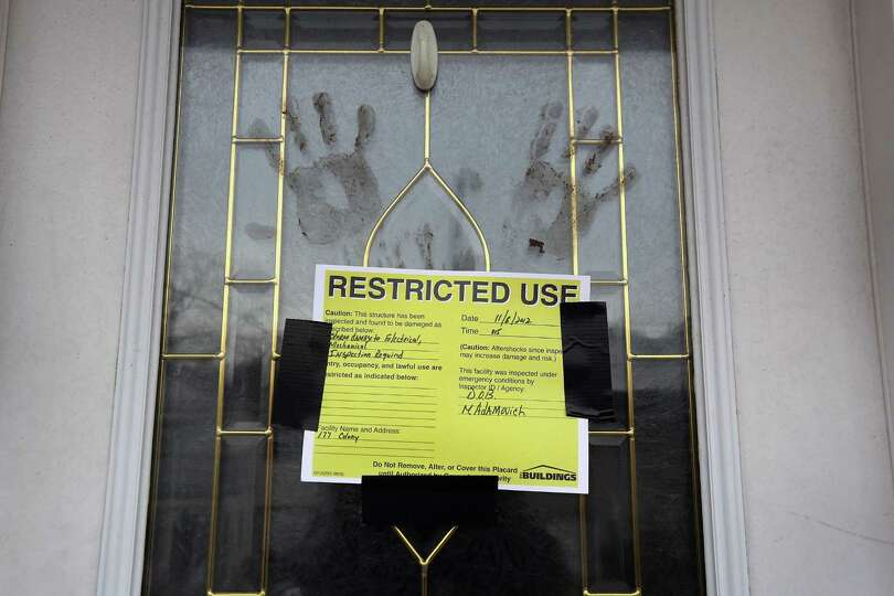 Muddy handprints mark the front door of a home that was heavily damaged by Superstorm Sandy on Novem