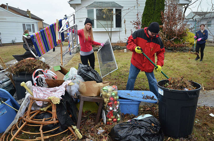 Holy Spirit High School senior Marina Poupart,  left, and  math teacher Kenneth Scott clean out a ho