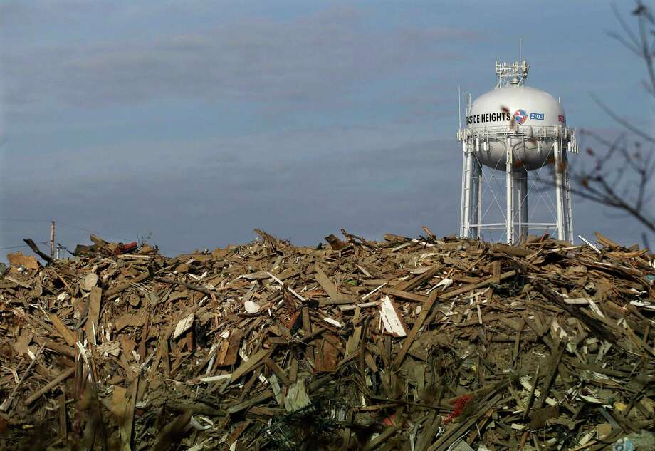 A huge pile of debris is seen in Seaside Heights, N.J., Monday, Nov. 12, 2012.  Clean-up continues two weeks after the region was pounded by Superstorm Sandy. Photo: Mel Evans, Associated Press / AP