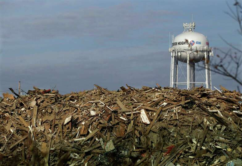 A huge pile of debris is seen in Seaside Heights, N.J., Monday, Nov. 12, 2012.  Clean-up continues t