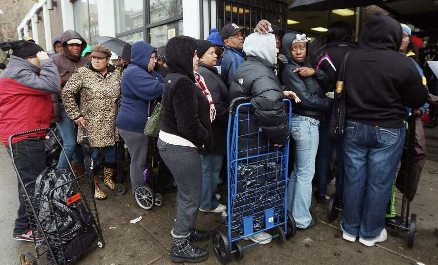 People wait on line to receive some of the 1,500 donated coats from New York Cares in the Far Rockaw