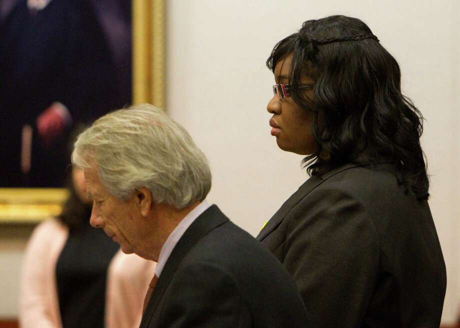 Standing next to her attorney, Mike DeGeurin, Jessica Tata did not react as the guilty verdict was read in her felony murder trial Tuesday. Photo: Johnny Hanson, Staff / © 2012  Houston Chronicle
