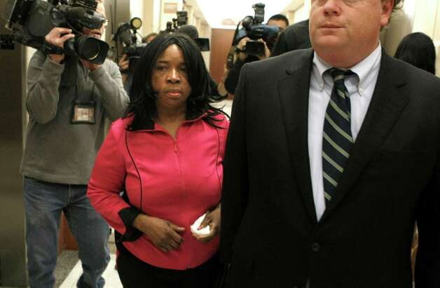 Jessica Tata's mother, Missy, leaves the courtroom after her daughter was convicted. Photo: Johnny Hanson, Staff / © 2012  Houston Chronicle