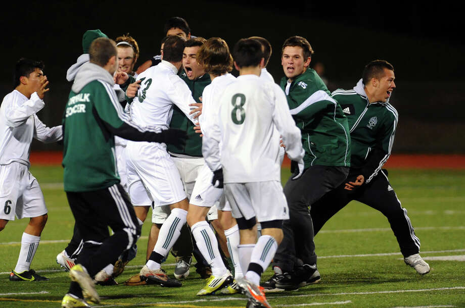 Norwalk celebrates its win over Newtown, during Class LL boys soccer quarterfinal action in Norwalk, Conn. on Tuesday November 13, 2012. Photo: Christian Abraham / Connecticut Post