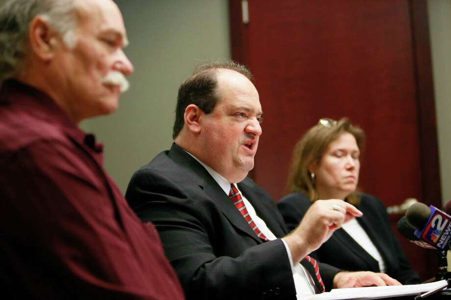 Attorney Steven M. Cohen speaks to reporters during a press conference to announce a $2.7 million settlement between New York State and his client, Lynn DeJac Peters, who was wrongfully convicted of murdering her daughter in 1993 and spent over 13 years in prison before being vindicated by DNA evidence, in a conference room at the office of Hogan Willig in Amherst, N.Y. Tuesday, Nov. 13, 2012.  A federal lawsuit against Erie County and the City of Buffalo is ongoing.  Cohen, center, is joined by Chuck Peters, left, husband of Lynn DeJac Peters, and attorney Diane Tiveron, right.(AP Photo/Buffalo News, Derek Gee)  TV OUT; MAGS OUT; MANDATORY CREDIT; BATAVIA DAILY NEWS OUT; DUNKIRK OBSERVER OUT; JAMESTOWN POST-JOURNAL OUT; LOCKPORT UNION-SUN JOURNAL OUT; NIAGARA GAZETTE OUT; OLEAN TIMES-HERALD OUT; SALAMANCA PRESS OUT; TONAWANDA NEWS OUT Photo: Derek Gee