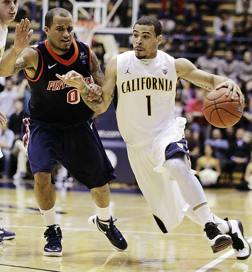 California's Justin Cobbs (1) drives past Pepperdine's Lorne Jackson, left, during the second half of an NCAA college basketball game, Tuesday, Nov. 13, 2012, in Berkeley, Calif. (AP Photo/Ben Margot) Photo: Ben Margot, Associated Press