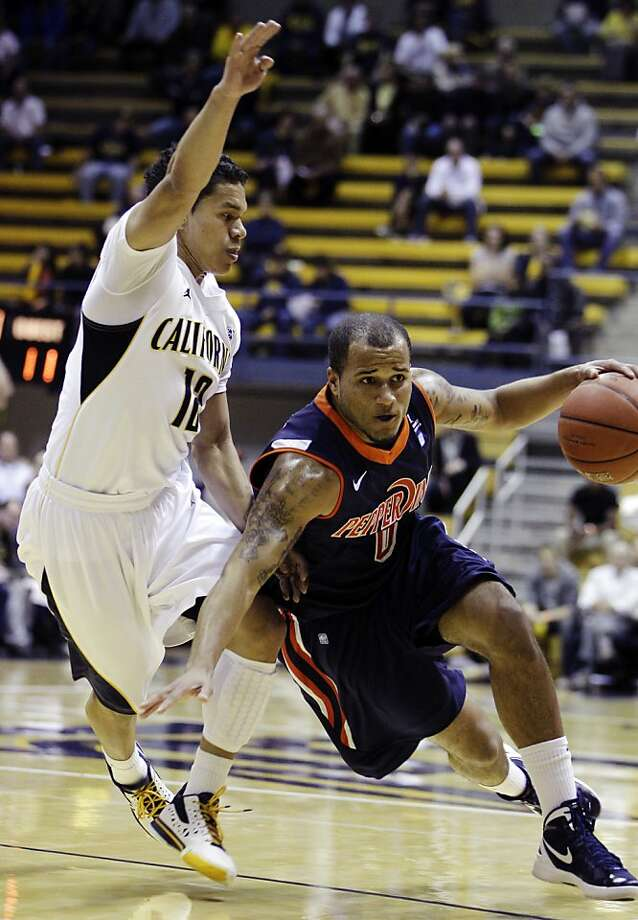 Pepperdine's Lorne Jackson, right, drives the ball against California's Brandon Smith (12) during the first half of an NCAA college basketball game, Tuesday, Nov. 13, 2012, in Berkeley, Calif. (AP Photo/Ben Margot) Photo: Ben Margot, Associated Press