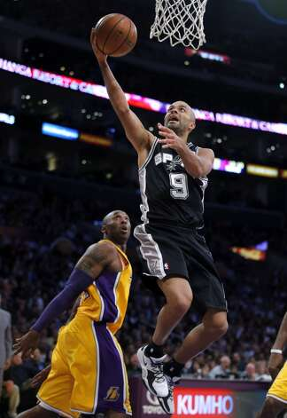 San Antonio Spurs' Tony Parker, of France, goes up for a basket as Los Angeles Lakers' Kobe Bryant, left, watches in the first half of an NBA basketball game in Los Angeles, Tuesday, Nov. 13, 2012. (AP Photo/Jae C. Hong) (Associated Press)