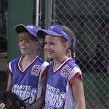 Best friends Brittany Stone (left) and Courtney Tietze, both 10, were softball teammates at the 2003 Helotes All-Star Tournament.  (Stone / MySanAntonio.com)