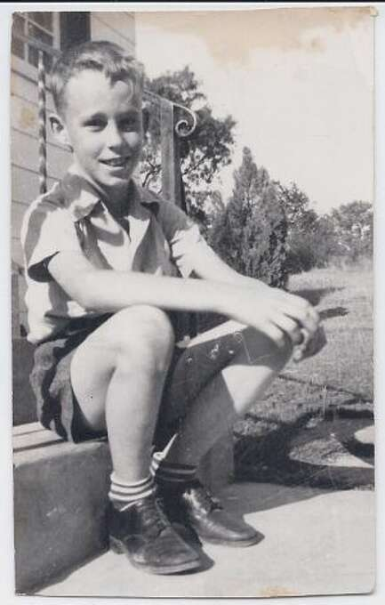 This photo is a picture of my Dad, Larry Bower, taken in 1942 at 8 years of age in front of his house.  (Joanna Brandt / MySanAntonio.com)