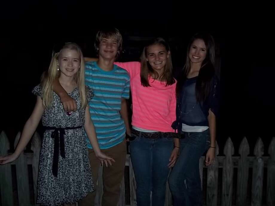 In 2004, cousins Madison Saulter (from left), Logan Saulter, Samantha Schulte and Kierstan Saulter took a photo at the home of their great aunt/grandmother Bonnie Keller in Castroville as they remembered their great-grandmother Fanny Keller, who died that year. In this photo, taken in 2012, the cousins are all teenagers, yet they still get together each September to honor their great-grandmother. The day includes a mass at St. Louis Church in Castroville followed by a family get-together and supper.  (Bonnie Keller / MySanAntonio.com)