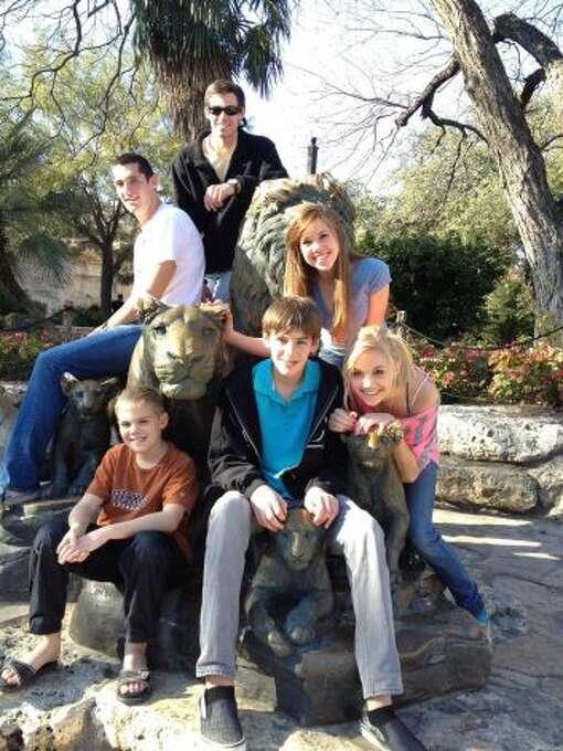 "The ""Lyle"" Grandkids at the San Antonio Zoo in 2011. Top down: Matt, Scott, Denise, Todd, Christy, & Caleb. (Carol Wilson / MySanAntonio.com)"