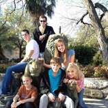 "The ""Lyle"" Grandkids at the San Antonio Zoo in 2011. Top down: Matt, Scott, Denise, Todd, Christy, & Caleb. (Carol Wilson / MySanAntonio.com)"