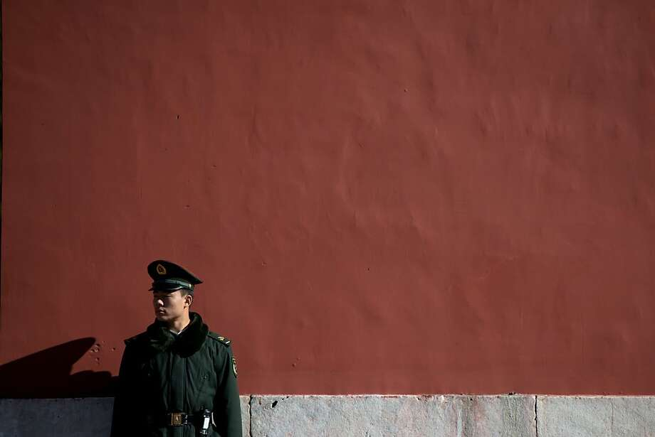 A paramilitary guard stands at a wall of the Forbidden City in Beijing on November 13, 2012. China's Communist Party will on November 15 unveil the new set of top leaders who will run the country for the next decade, one day after its week-long congress ends. Photo: Ed Jones, AFP/Getty Images