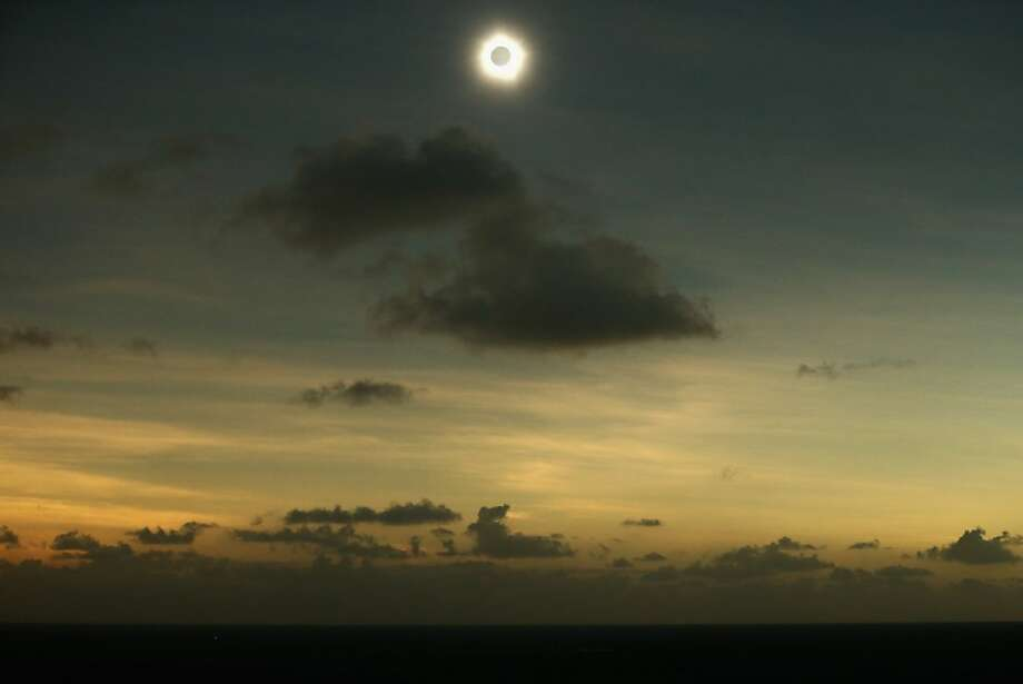 Totality is seen during the solar eclipse at Vlassof Cay on November 14, 2012 in Palm Cove, Australia on November 14, 2012 in Cairns, Australia. Thousands of eclipse-watchers have gathered in part of North Queensland to enjoy the solar eclipse, the first in Australia in a decade. Photo: Mark Kolbe, Getty Images