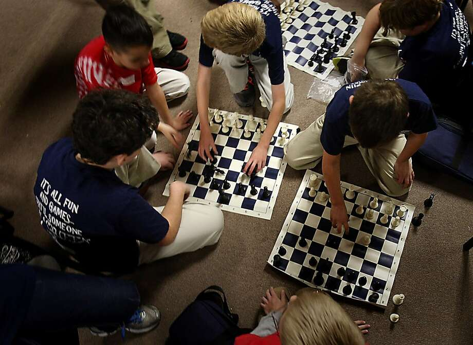 Fourth and fifth graders from Lewisburg Elementary School continue play even during breaks between matches of DeSoto County Schools chess tournament on Tuesday Nov. 13, 2012 in Desoto County Mississippi.  The two-day event has 505 students scheduled to participate in various divisions from fourth through twelfth grades. Photo: Stan Carroll, Associated Press