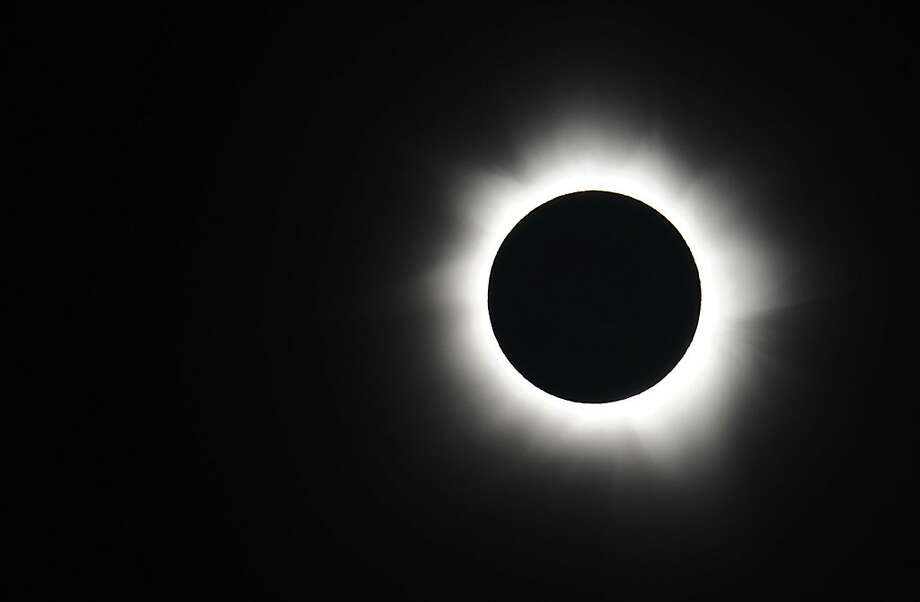 PALM COVE, AUSTRALIA - NOVEMBER 14:  Totality is seen during the solar eclipse at Palm Cove on November 14, 2012 in Palm Cove, Australia. Thousands of eclipse-watchers have gathered in part of North Queensland to enjoy the solar eclipse, the first in Australia in a decade.  (Photo by Ian Hitchcock/Getty Images) Photo: Ian Hitchcock, Getty Images