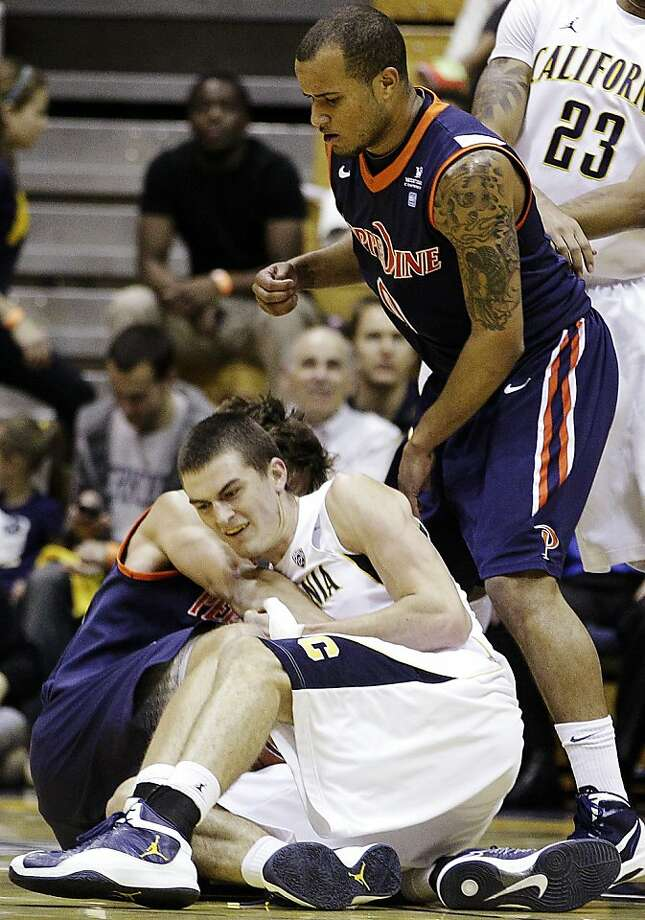 California's David Kravish, bottom, fights for the ball with Pepperdine's Jett Raines as Lorne Jackson (0) watches during the first half of an NCAA college basketball game, Tuesday, Nov. 13, 2012, in Berkeley, Calif. (AP Photo/Ben Margot) Photo: Ben Margot, Associated Press