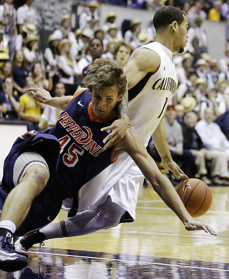 California's Justin Cobbs, right, drives the ball away from Pepperdine's Jett Raines (45) during the first half of an NCAA college basketball game, Tuesday, Nov. 13, 2012, in Berkeley, Calif. (AP Photo/Ben Margot) Photo: Ben Margot, Associated Press