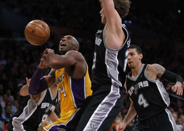 Los Angeles Lakers' Kobe Bryant, left, is defended by San Antonio Spurs' Tiago Splitter, of Brazil, in the second half of an NBA basketball game in Los Angeles, Tuesday, Nov. 13, 2012. The Spurs won 84-82. (AP Photo/Jae C. Hong) (Associated Press)