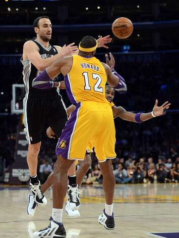 Manu Ginobili #20 of the San Antonio Spurs makes a pass in front of Dwight Howard #12 and Antawn Jamison #4 of the Los Angeles Lakers during a 84-82 Spurs win at Staples Center on November 13, 2012 in Los Angeles, California. (Harry How/Getty Images) (Getty Images)
