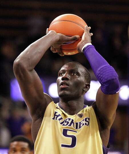 Washington's Aziz N'Diaye lines up the first of two free throws in the final minute of an NCAA colle