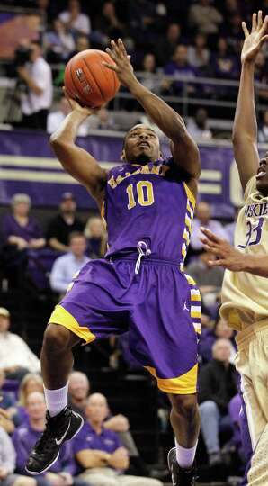 Albany's Mike Black shoots against Washington in the second half of an NCAA college basketball game,