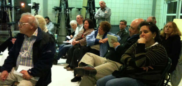 Neighbors listen to a presentation on the mixed-use development proposed on Old Stratfield Road during Tuesday night's meeting of the Town Plan and Zoning Commission in McKinley School. Photo: Associated Press, Andrew Brophy / Fairfield Citizen contributed
